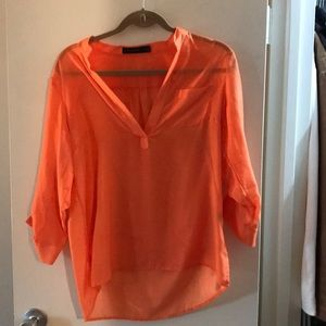 The limited orange sheer blouse